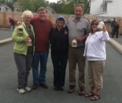 The winning team poses for a photo at Mentor Connector's bocce fundraising event.