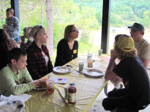During lively group discussions at the Windsor County Partners Annual Meeting and Picnic, mentors and parents shared stories and activity ideas for the coming year.