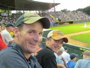 Spectrum mentor Sam Smith and his mentee Cole enjoy a Vermont Lake Monsters game together.