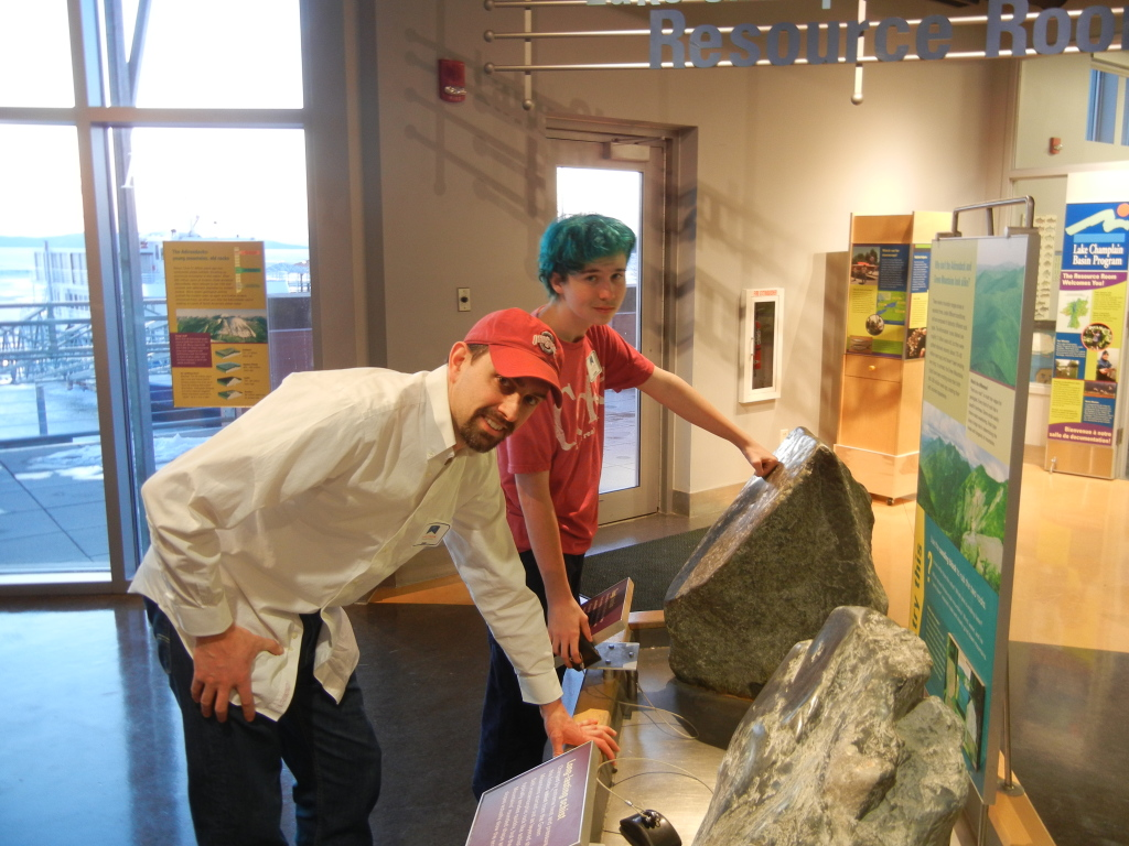 Spectrum mentor Dan Evans and his mentee Andrew explore a science exhibit together.