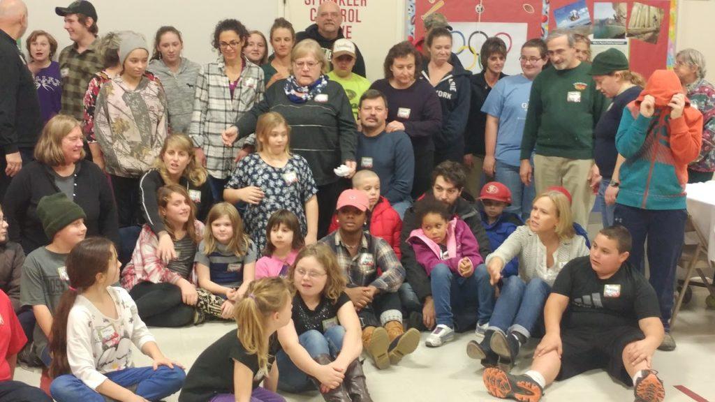 Group shot of mentors and mentees at Starksboro Mentoring Pizza and Game Night 2016